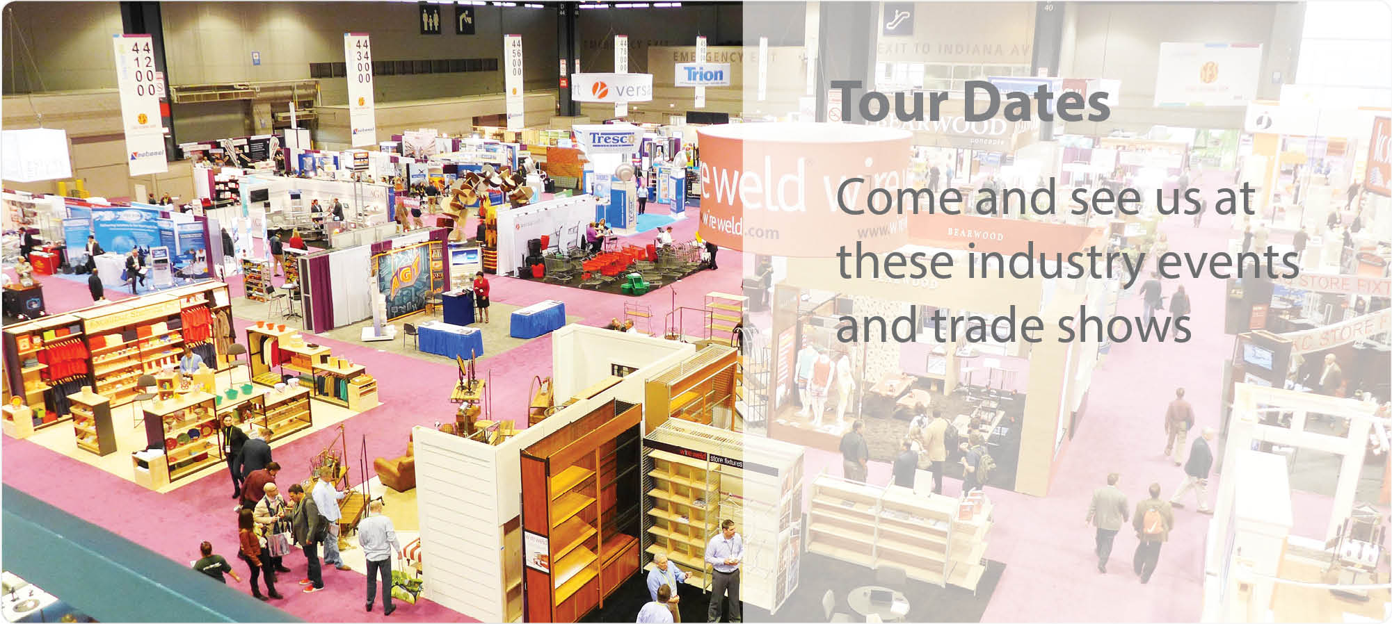 Image of a trade show as seen from above, Versacart booth can be seen in amongst other trade show booths.
